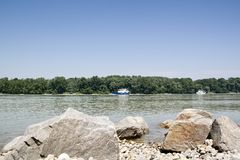 Donau river with boat and rocks Royalty Free Stock Image