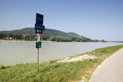 Donau river with boat and rocks Stock Photo