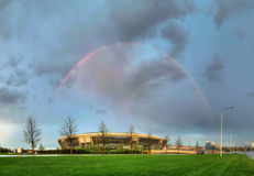Donbass Arena stadium in the spring of 2012. DONETSK, UKRAINE - After the Rain: Donbass Arena stadium in the spring of 2012 with a rainbow in Donetsk, Ukraine Royalty Free Stock Images