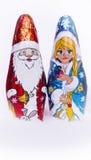 Doncella y Santa Claus de la nieve del chocolate ilustración del vector