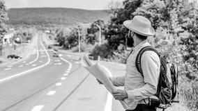 Donde debo ir El viajar perdido de la dirección del mapa turístico del backpacker En todo el mundo El mapa permite reconoce basta fotos de archivo