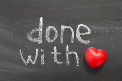 Done with love. Phrase handwritten on school blackboard stock photo