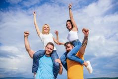 Done it in one. Loving couples having fun activities outdoor. Loving couples enjoy fun together. Happy men piggybacking. Their girlfriends. Playful couples in stock images