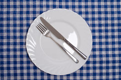 Done - table manners. Isolated on blue tablecloth Stock Image