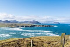 Donegal Ireland Seascape. This is a picture of the waves coming into Five Finger Stand beach in Donegal Ireland. Doagh island can be seen in the background stock photo