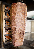 Doner Kebab. Turkish doner kebab on special grill stock images