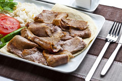 Doner Kebab. Turkish traditional food with tomato and rice stock photo