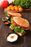 Doner kebab - falafel fresh vegetables in pita Brad Stock Images