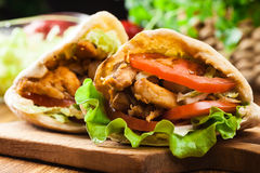 Doner kebab - fried chicken meat with vegetables Stock Images