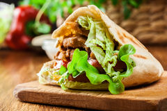 Doner kebab - fried chicken meat with vegetables Stock Photography