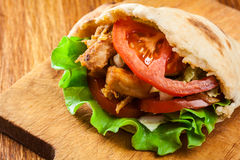 Doner kebab - fried chicken meat with vegetables royalty free stock image