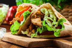 Doner kebab - fried chicken meat with vegetables royalty free stock photos