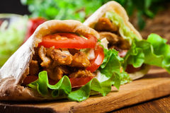 Doner kebab - fried chicken meat with vegetables stock image