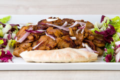 Doner kebab - fried chicken meat with vegetables in pita bread Royalty Free Stock Photo