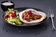 Doner kebab - fried chicken meat with vegetables in pita bread Royalty Free Stock Photography
