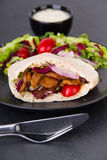 Doner kebab - fried chicken meat with vegetables in pita bread Stock Image