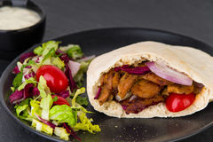 Doner kebab - fried chicken meat with vegetables in pita bread Stock Images