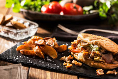 Doner kebab with fried potato on table Royalty Free Stock Photos