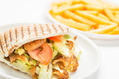 Doner kebab. With fries isolated on white background royalty free stock photos
