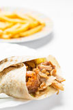 Doner kebab. With fries isolated on white background royalty free stock photo