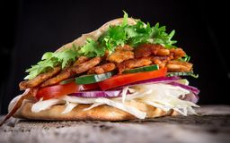 Doner Kebab. Grilled meat, bread and vegetables stock photo