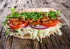 Doner Kebab - grilled meat, bread and vegetables Royalty Free Stock Photos