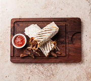 Doner Kebab. Grilled meat and vegetables on stone textured background Royalty Free Stock Photo