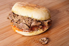 Doner kebab isolated. Doner kebab sandwich isolated on wooden board Stock Photo