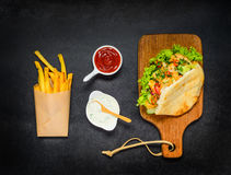 Doner Kebab with Ketchup and Fried Potatoes Stock Photos