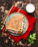 Doner kebab with meat cutlets and vegetables on a plate with a red napkin and garlic sauce On wooden rustic background, top view. Doner kebab with meat cutlets stock images