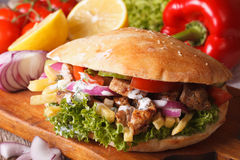 Doner kebab with meat and vegetables closeup. horizontal. Doner kebab with meat and vegetables in pita bread closeup. horizontal royalty free stock photography