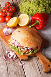 Doner kebab in pita bread closeup. vertical top view Stock Photos