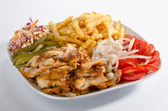 Doner kebab on a plate. With french fries and salad Stock Photo