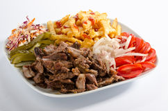 Doner kebab on a plate. With french fries and salad Royalty Free Stock Photo