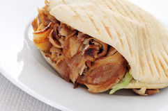 Doner kebab. A doner kebab in a plate on a set table Royalty Free Stock Images