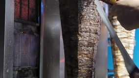 Doner kebab / pressed meat roasted on a large vertical spit stock video