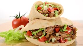 Doner kebab. Kebab rotating over white background stock video footage