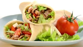 Doner kebab. Kebab rotating over white background stock footage