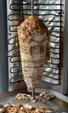 Doner kebab. On a rotating spit Stock Photos