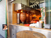 Doner kebab. Shop in Thessaloniki, Greece. Donner kebab is a Turkish dish made of meat cooked on a vertical spit, normally lamb but also a mixture of veal or stock images