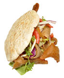 Doner Kebab. A takeaway doner kebab in a pita bread, isolated on a white background Royalty Free Stock Image