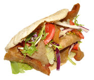 Doner Kebab. A takeaway doner kebab in a pita bread, isolated on a white background royalty free stock photography