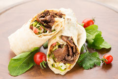 Doner kebab on wooden background Royalty Free Stock Photography