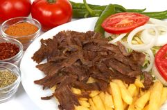 Doner kebap. With french fries and salads royalty free stock photos