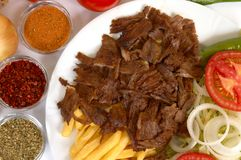 Doner kebap. With french fries and salads Stock Photo