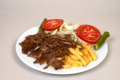 Doner kebap. With french fries and salads stock photos