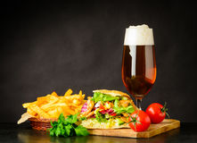 Doner Kebap Sandwich with Beer and French Fries Royalty Free Stock Photos