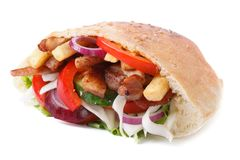 Doner with meat, vegetables and fries in pita isolated on white Stock Photos