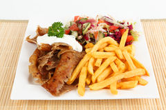 Doner. Turkish doner with french fries and salad royalty free stock images