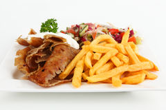Doner. Turkish doner with french fries and salad Stock Photos